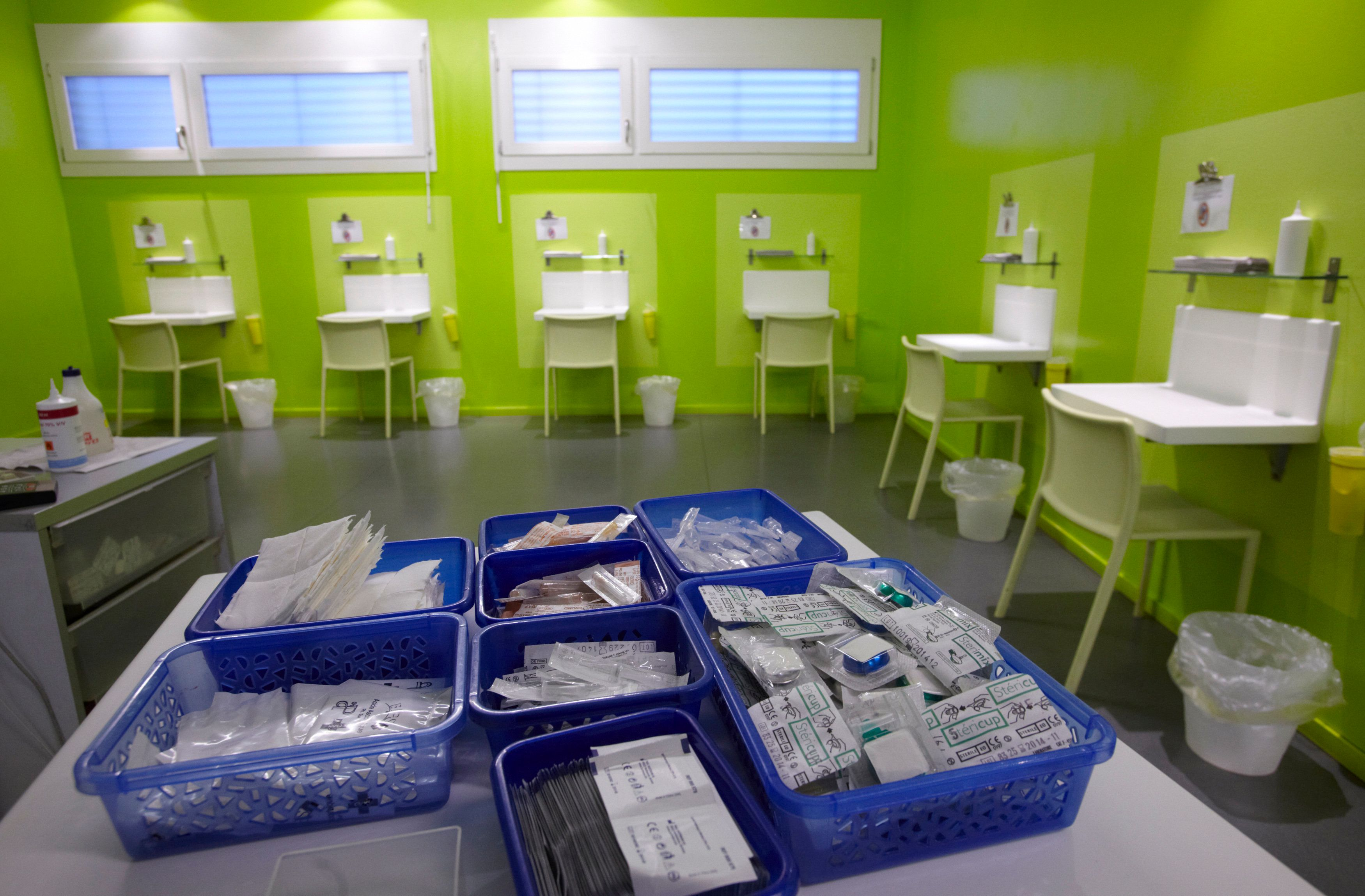 Kits of supplies containing syringes, bandages and antiseptic pads inside a safe injection site in Switzerland.