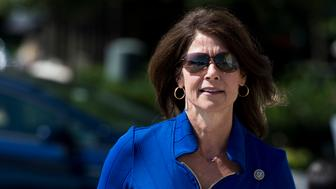 UNITED STATES - JULY 19: Rep. Cheri Bustos, D-Ill., walks up the House steps for the final votes of the week on Thursday, July 19, 2018. (Photo By Bill Clark/CQ Roll Call)