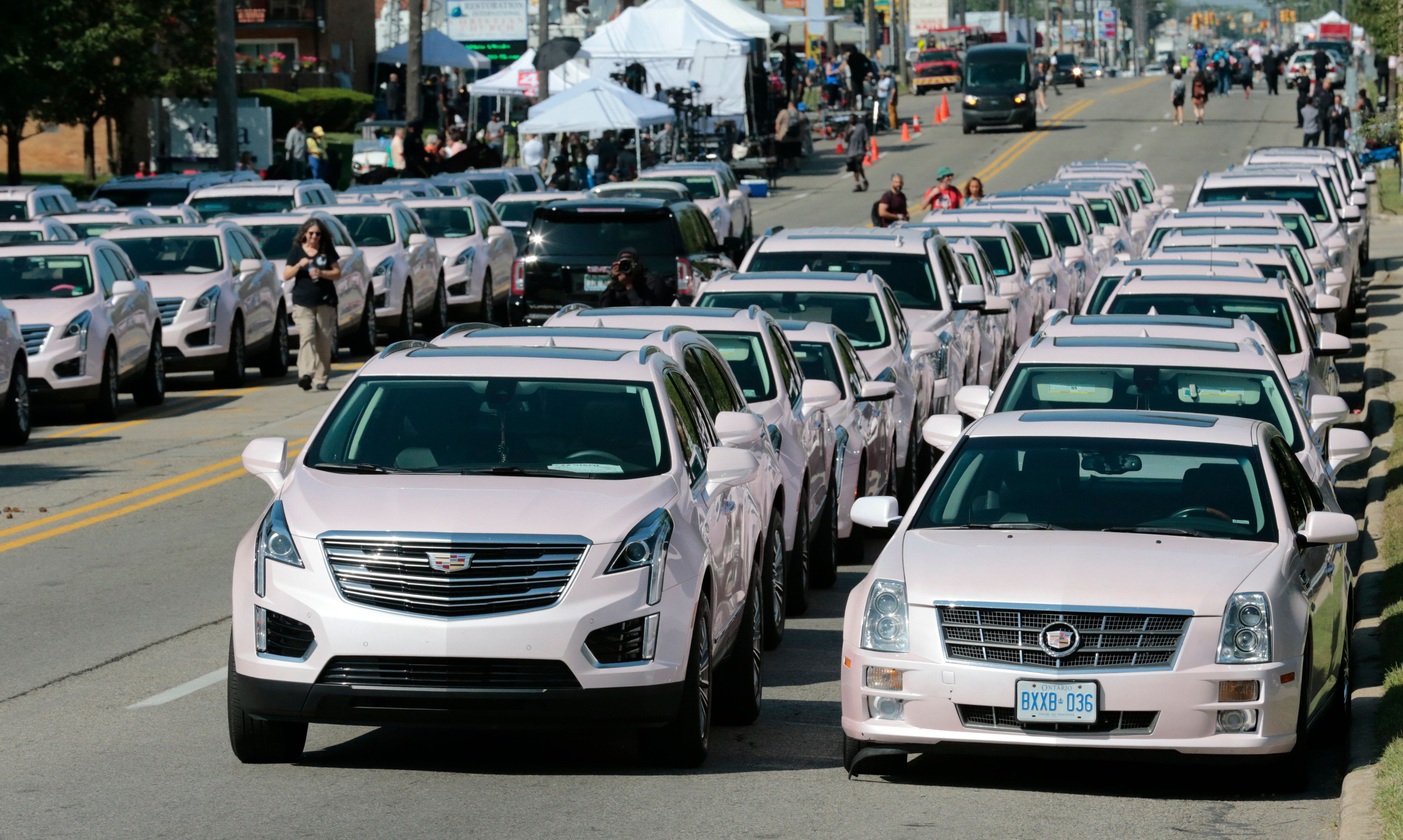 Pink Cadillacs line Seven Mile Road in front of Aretha Franklin's funeral at the Greater Grace Temple