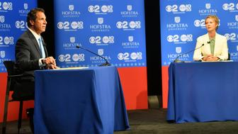 Governor Andrew M. Cuomo speaks at the Democratic gubernatorial primary debate with Cynthia Nixon at Hofstra University in Hempstead, New York August 29, 2018.    J. Conrad Williams Jr./Pool via REUTERS