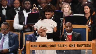 Aretha Franklin's grandchildren Jordan and Victorie Franklin embrace during Aretha Franklin's funeral at Greater Grace Temple on August 31, 2018 in Detroit, Michigan. (Photo by Angela Weiss / AFP)        (Photo credit should read ANGELA WEISS/AFP/Getty Images)
