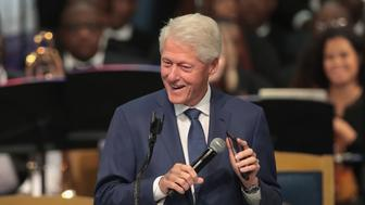 DETROIT, MI - AUGUST 31:  Former President Bill Clinton plays an Aretha Franklin song from his phone while he speaks at the funeral for the singer at the Greater Grace Temple on August 31, 2018 in Detroit, Michigan. Franklin, 76, died at her home in Detroit on August 16.  (Photo by Scott Olson/Getty Images)