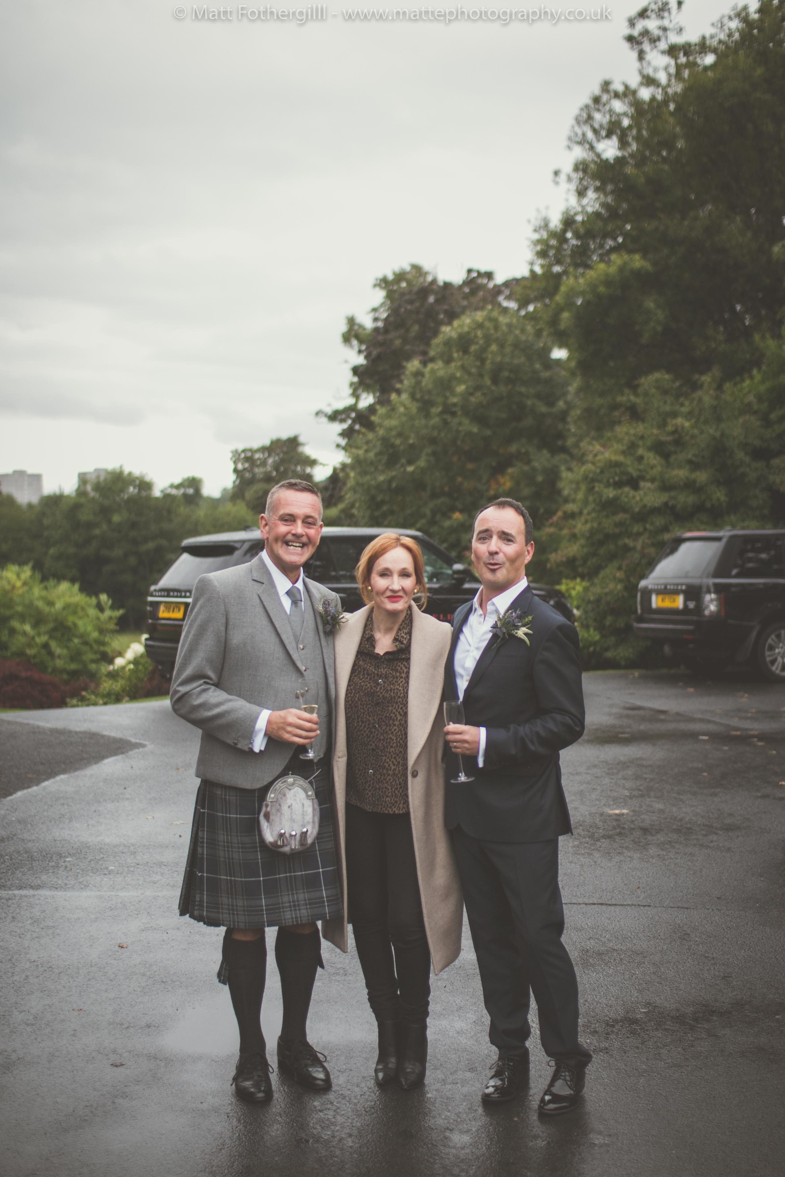 <i>Harry Potter</i> author J.K. Rowling surprised two Scottish newlyweds by posing with them on their wedding day. &nbsp