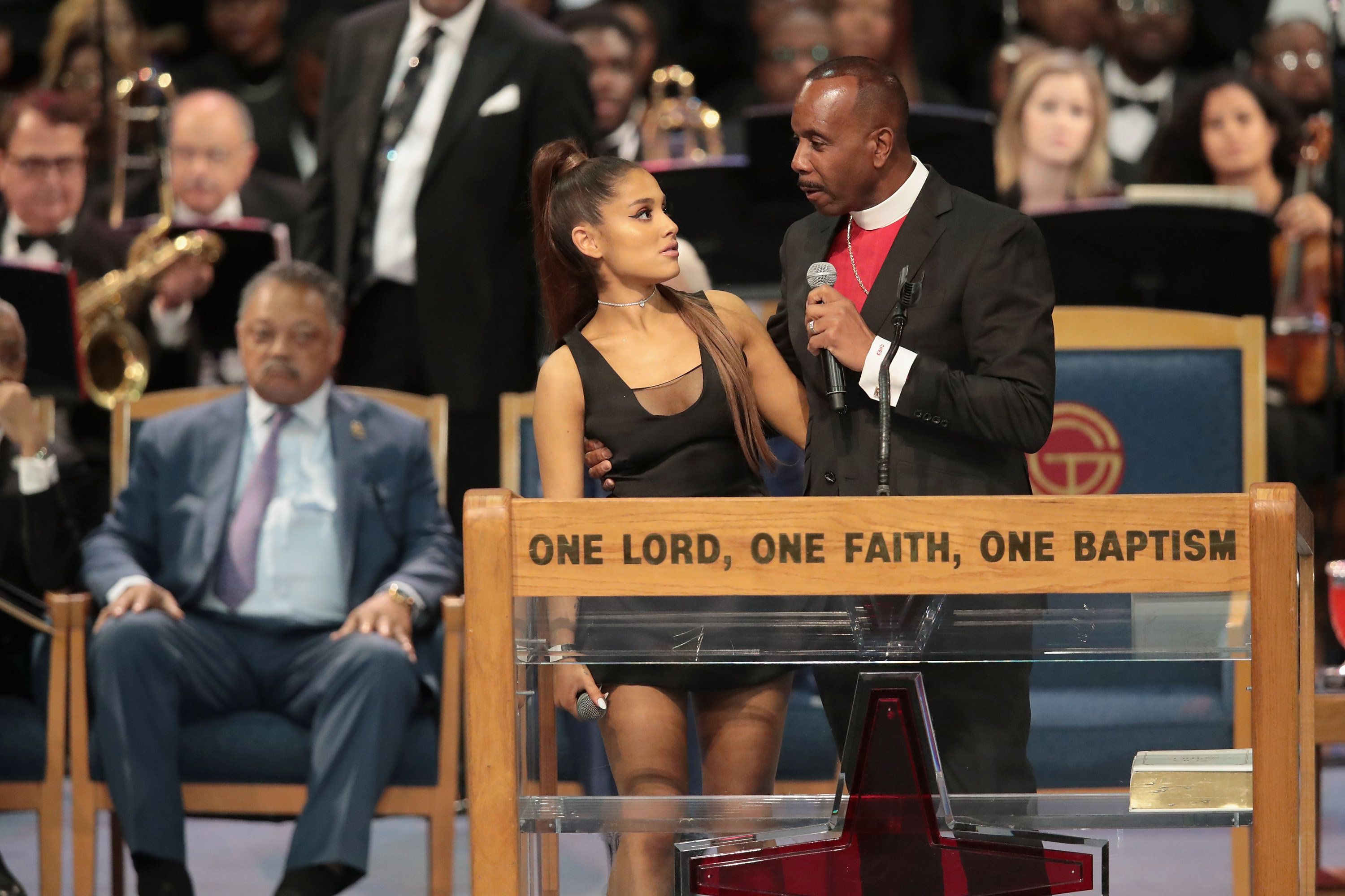 DETROIT, MI - AUGUST 31:  Singer Ariana Grande speaks with Bishop Charles Ellis III after performing at the funeral for Aretha Franklin at the Greater Grace Temple on August 31, 2018 in Detroit, Michigan. Franklin died at the age of 76 at her home in Detroit on August 16.  (Photo by Scott Olson/Getty Images)