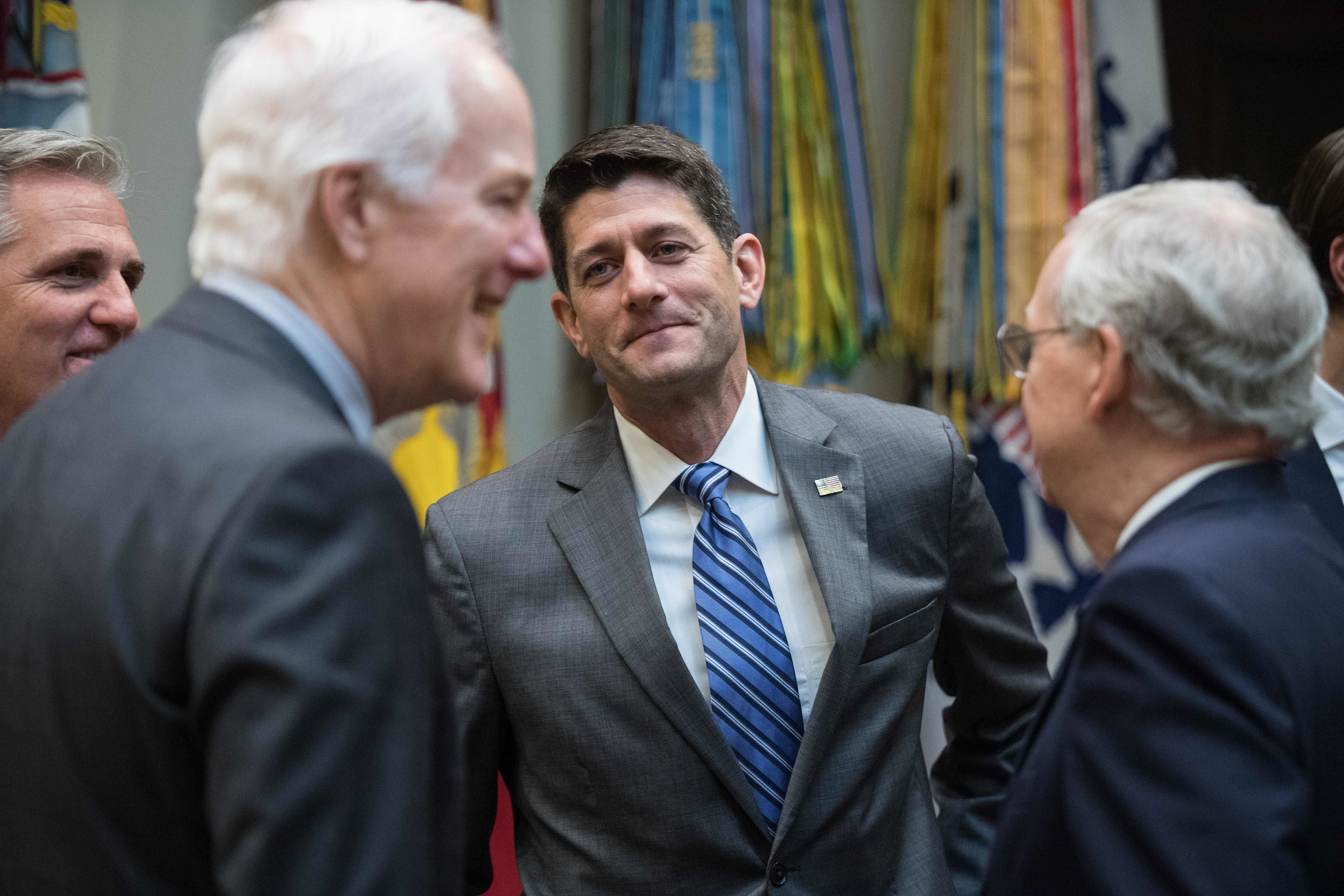 House Speaker Paul Ryan speaks with Senate Majority Leader Mitch McConnell (R), House Majority Leader Kevin McCarthy (L) and Senate Majotiy Whip John Cornyn (2nd L)) before a meeting of the House and Senate leadership with Trump in the Roosevelt Room at the White House in Washington, DC, on June 6, 2017. / AFP PHOTO / NICHOLAS KAMM        (Photo credit should read NICHOLAS KAMM/AFP/Getty Images)