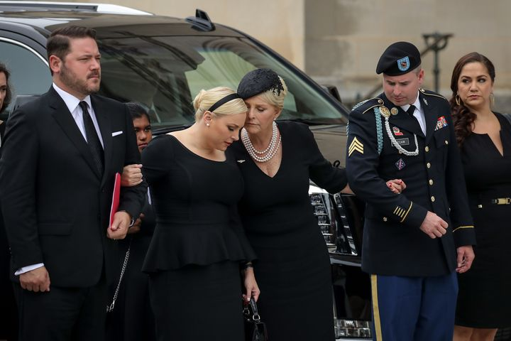 Meghan McCain and her mother Cindy McCain embrace as the casket of the late Senator John McCain arrives at the Washington Nat