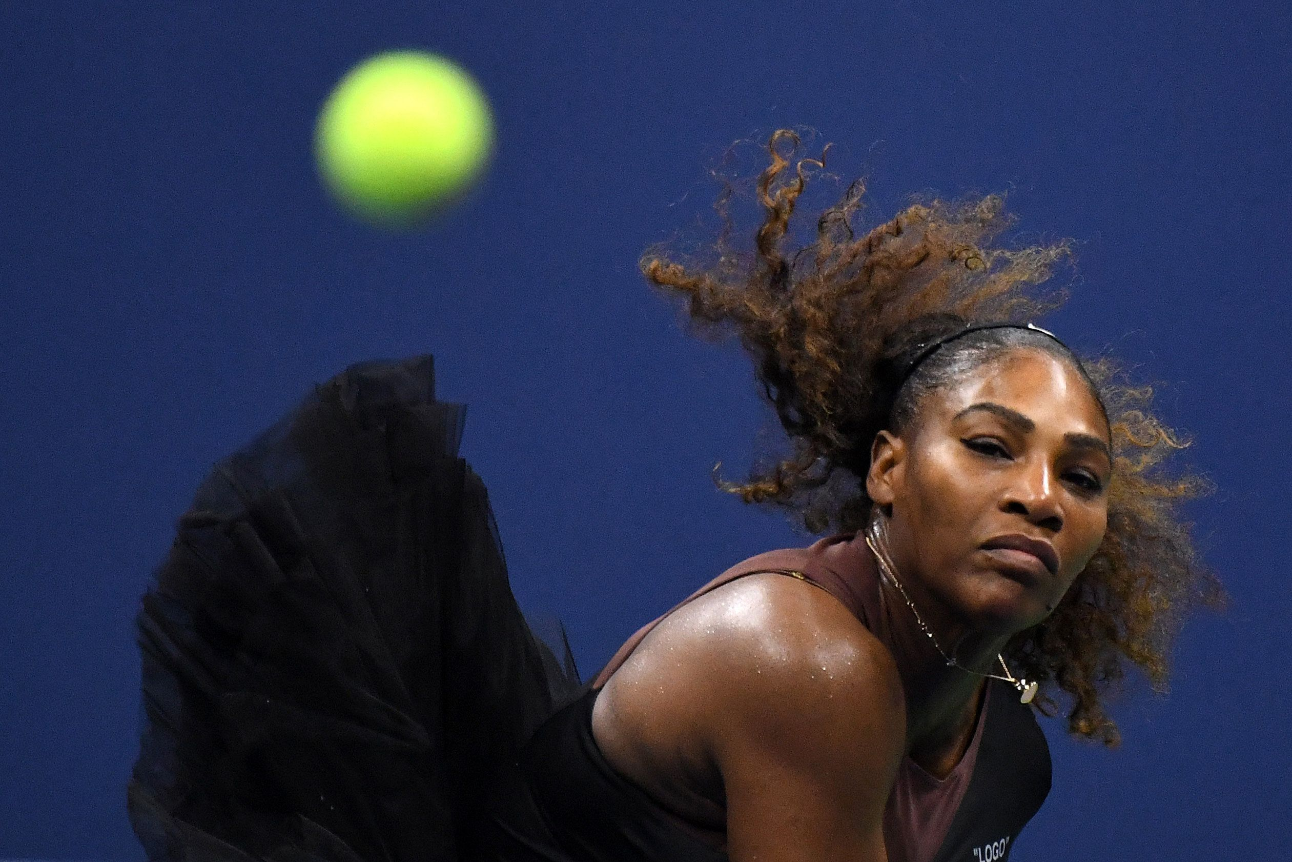 Serena Williams serves to sister Venus at US Open August 31