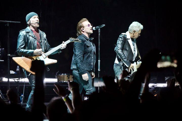 The Edge, Bono and Adam Clayton of the Irish band U2 performing in Berlin on Friday night.