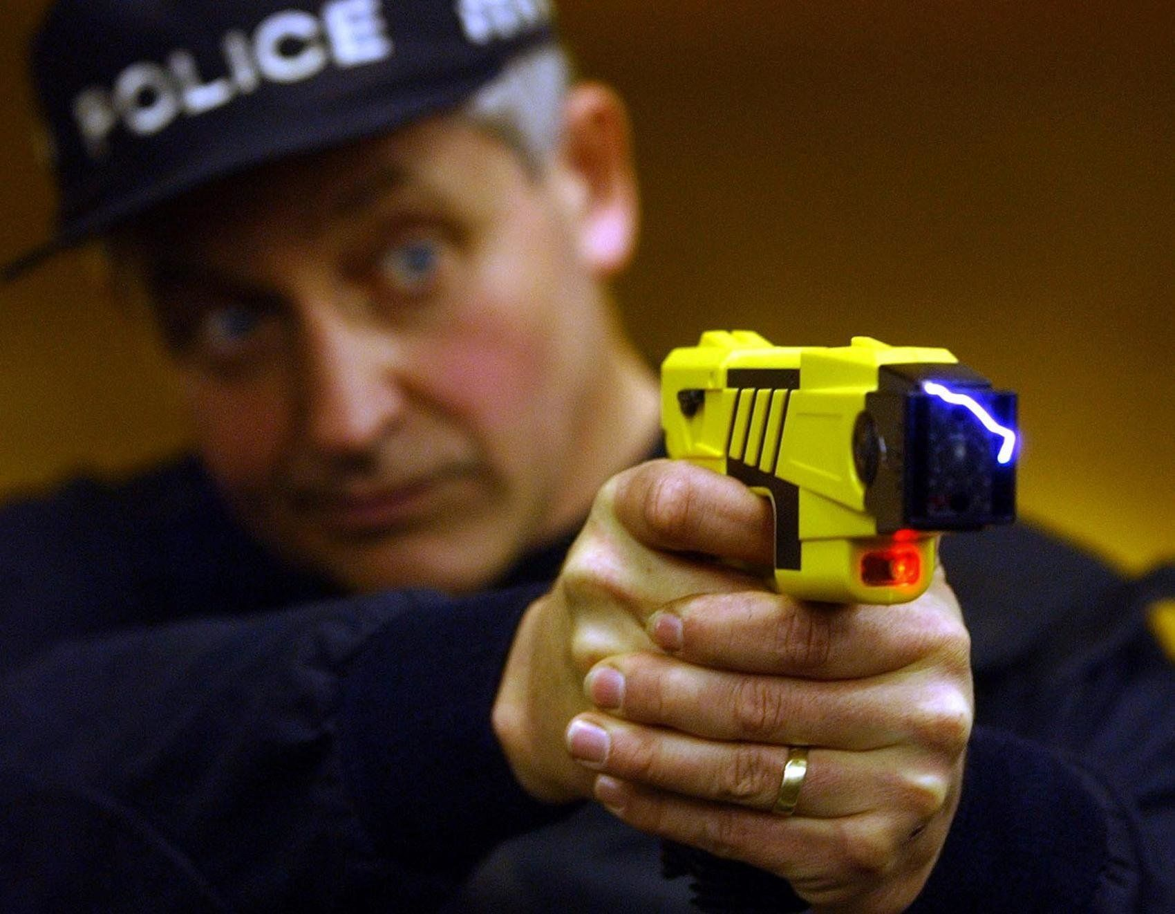 A policeman demonstrates how a taser is used at the firearms range of Northamptonshire Police (stock