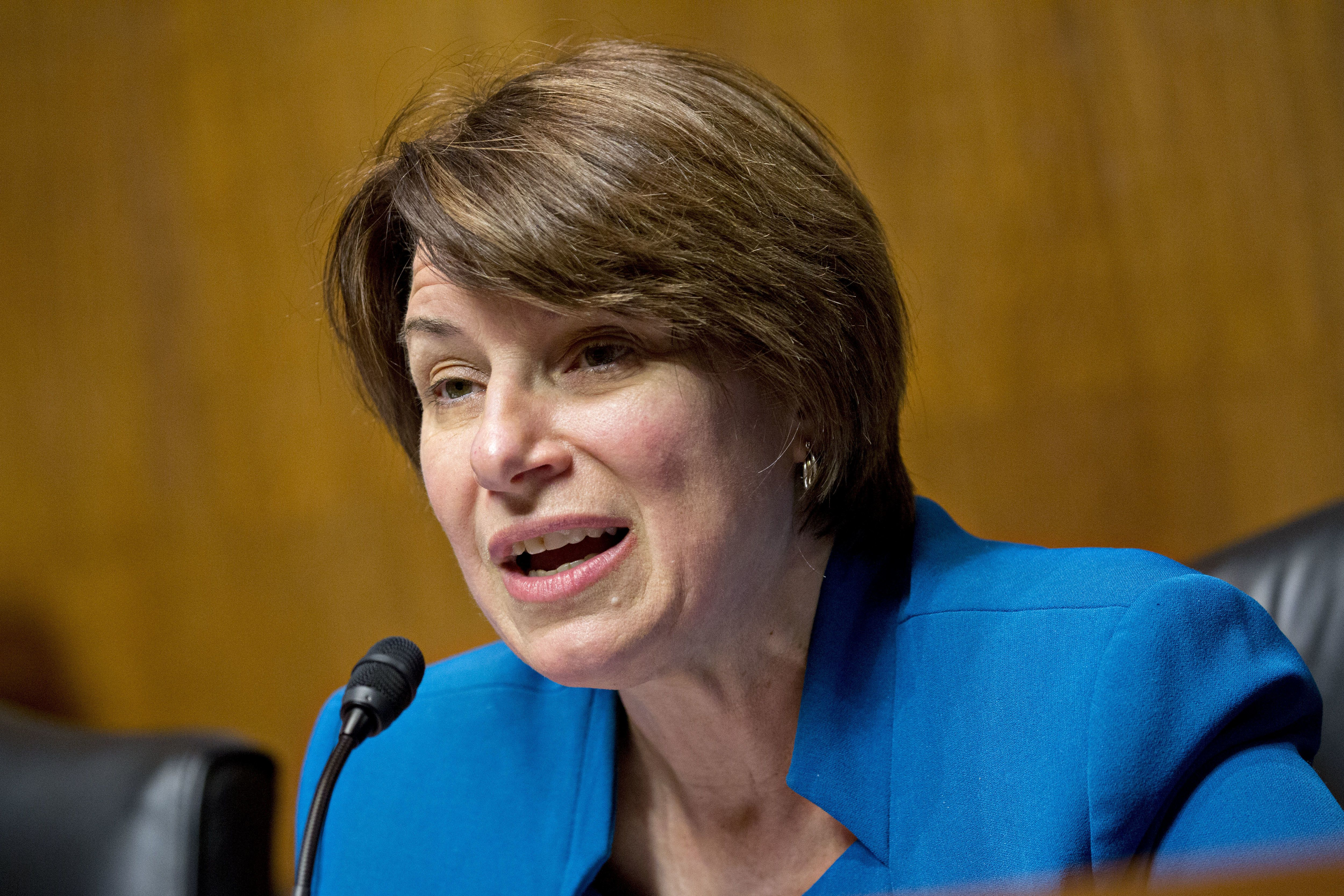 Senator Amy Klobuchar, a Democrat from Minnesota and ranking member of the Senate Judiciary Subcommittee on Antitrust, Competition Policy, and Consumer Rights, makes an opening statement during a hearing on the impact of the T-Mobile and Sprint transaction in Washington, D.C., U.S., on Wednesday, June 27, 2018. The T-Mobile US Inc. Chief Executive Officer told lawmakers his company's proposed purchase of Sprint Corp. will bring lower prices, while a former U.S. antitrust official said the deal poses dangers from less competition. Photographer: Andrew Harrer/Bloomberg via Getty Images