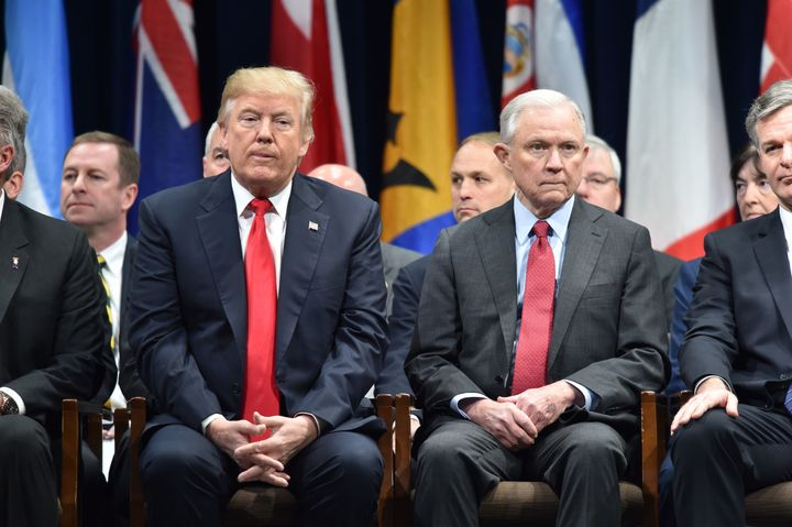 President Donald Trump sits next to Attorney General Jeff Sessions at the FBI National Academy graduation ceremony on Dec. 15