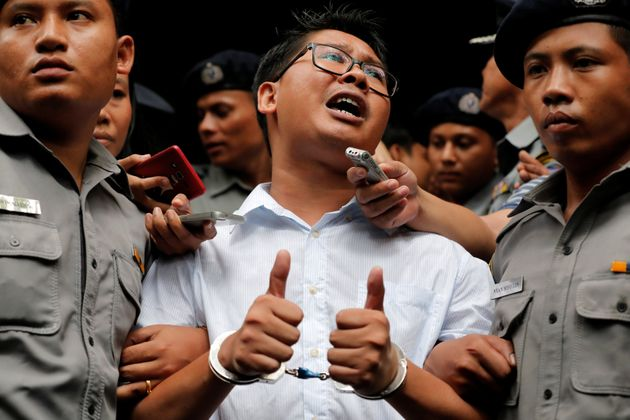 Reuters journalist Wa Lone leaves after listening to the verdict at Insein court in Yangon, Myanmar,...
