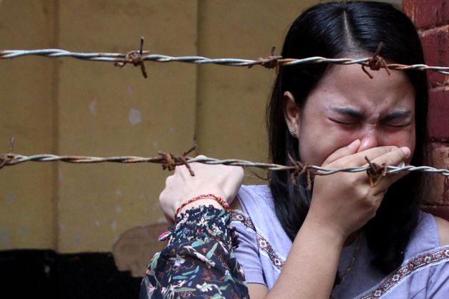 Chit Suu Win, wife of Reuters journalist Kyaw Soe Oo, reacts after listening to the the verdict at Insein...