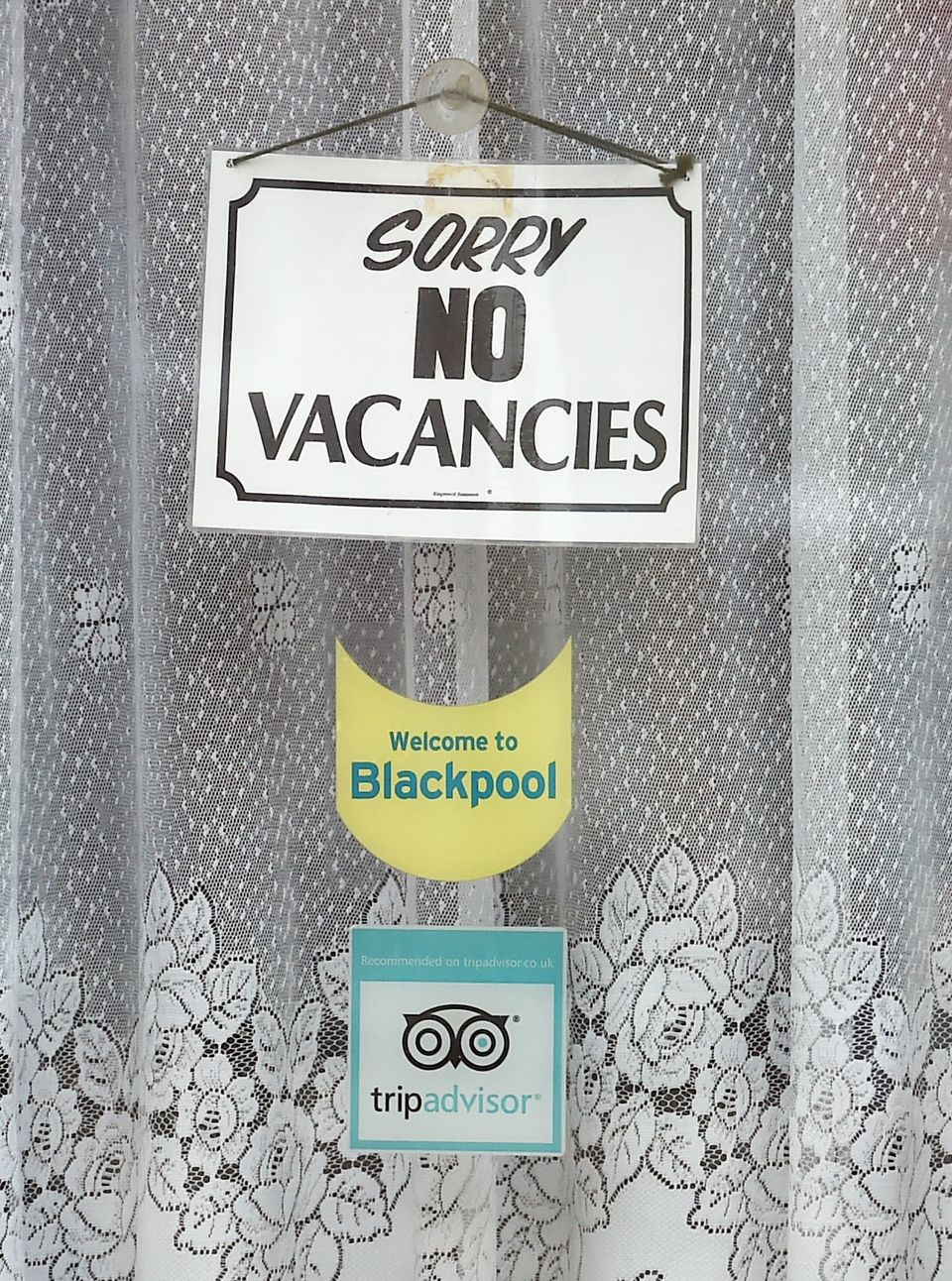 A vacancy sign is seen in the window of a Bed and Breakfast guest house in