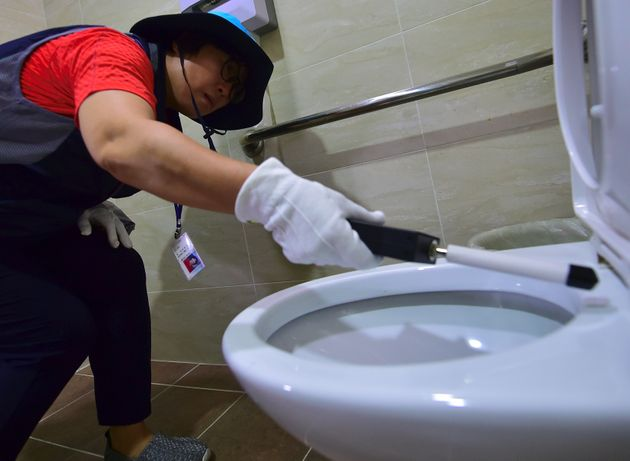 A government employee carrying out a toilet check in August
