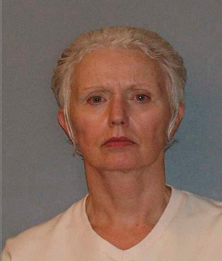 Greig in a booking photo released after her arrest in 2011. She was convicted of conspiracy to harbor a fugitive and criminal