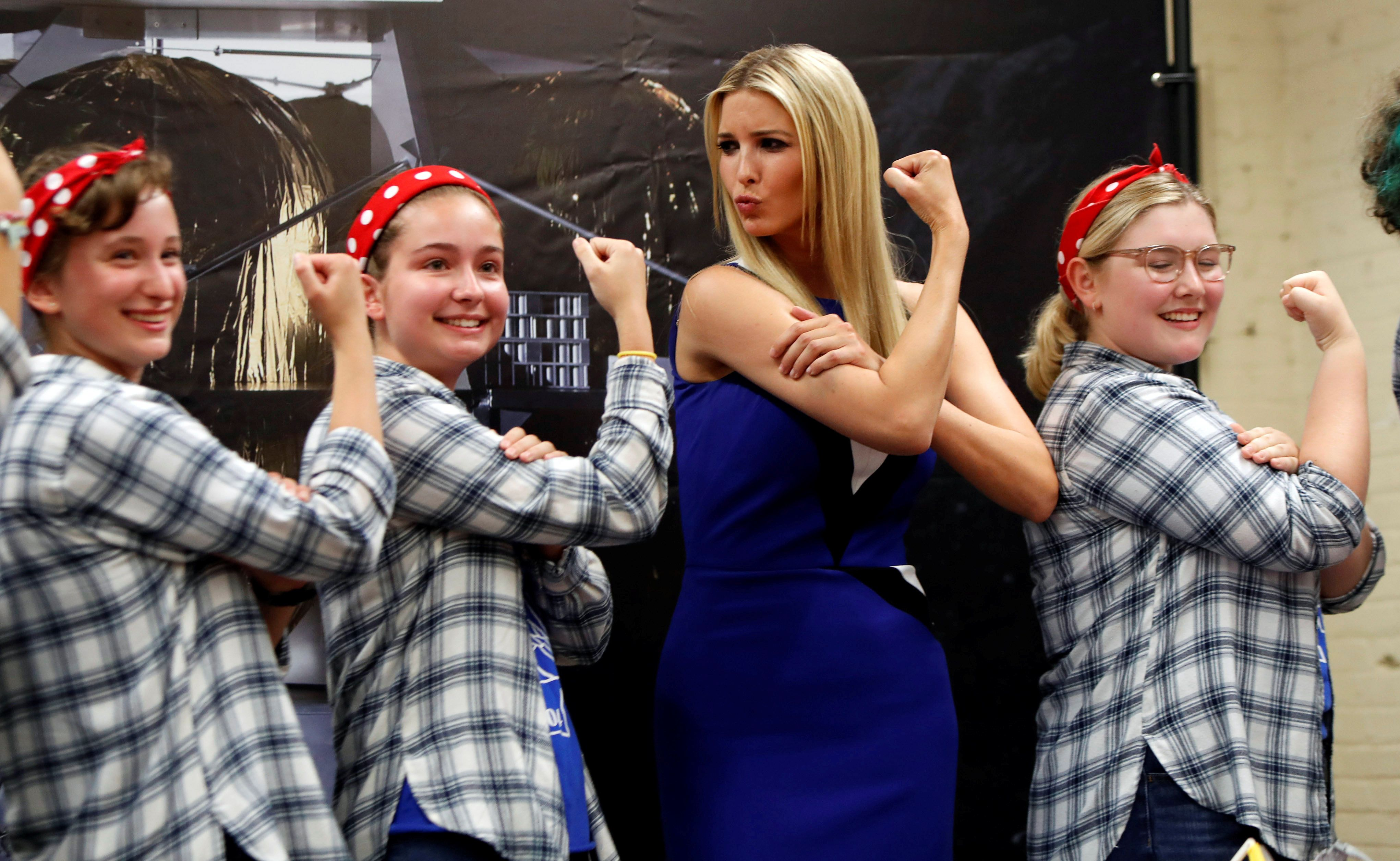 Ivanka Trump poses with Kristina Hilko, Lauren Shovlin, and Anna Nesbitt, members of the Girls of Steel Robotics initiative, at the Astrobotic Technology facility in Pittsburgh, Pennsylvania, U.S., August 14, 2018.  REUTERS/Jason Cohn