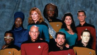 Promotional portrait of the cast of 'Star Trek: The Next Generation,' California, 1987. Pictured are from left, front row, American actor LeVar Burton (as Lieutenant Commander Geordi La Forge), British actor Patrick Stewart (as Captain Jean-Luc Picard), and American actors Jonathan Frakes (as Commander William T. Riker) and Brent Spiner (as Lieutenant Commander Data); from left, back row, American actors Whoopi Goldberg (as Guinan), Gates McFadden (as Doctor Beverly Crusher), and Michael Dorn (as Lieutenant Worf), British-American actress Marina Sirtis (as Counselor Deanna Troi), and American actor Wil Wheaton (as Wesley Crusher). (Photo by CBS Photo Archive/Getty Images)
