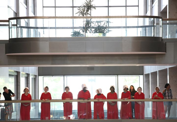 "Protesters dressed in ""The Handmaid's Tale"" costumes stand outside the hearing room where Supreme Court nominee Judge Brett K"