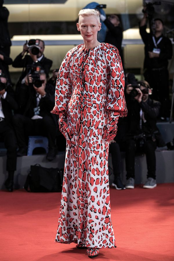 The actress wears a printed gown by Schiaparelli for the