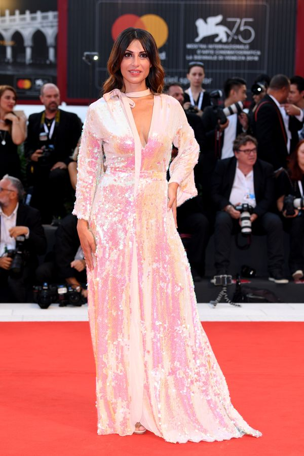 The singer and actress wears a sequined gown by Eleonora Lastrucci at the