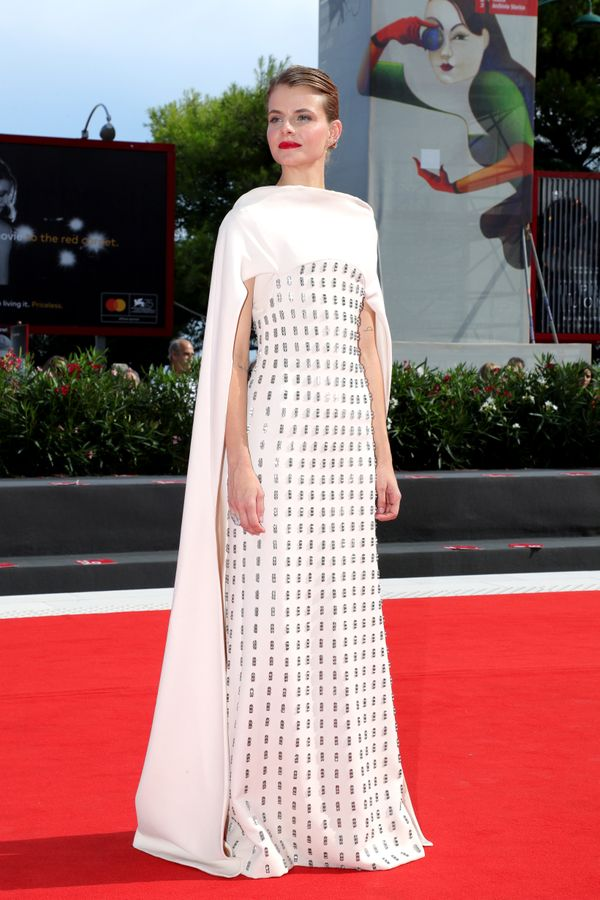 The actress stands on the red carpet ahead of the