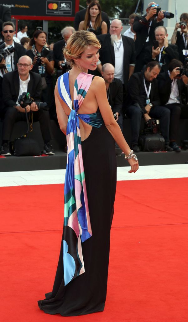 The singer wears an Emilio Pucci gown for the