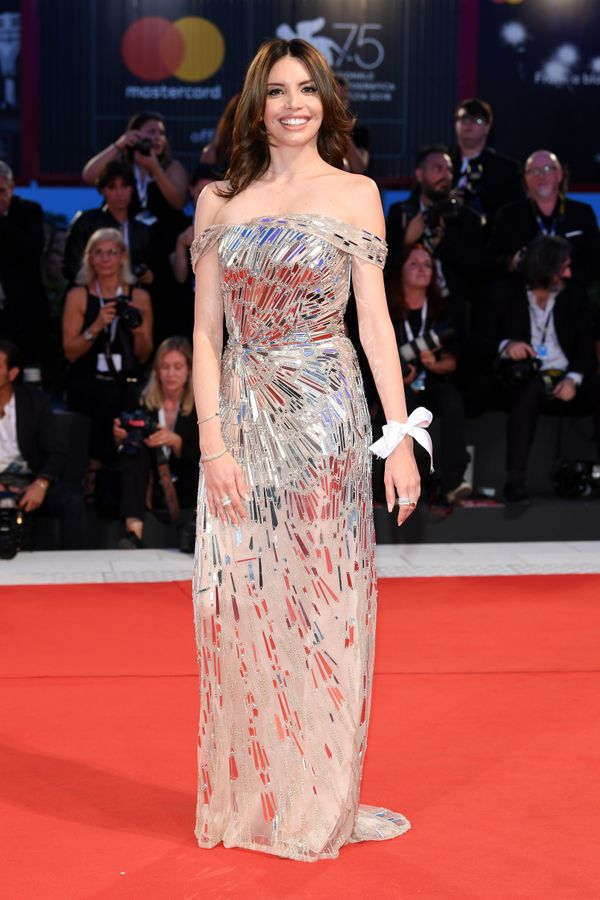 The actress wears an Antonio Grimaldi gown for the