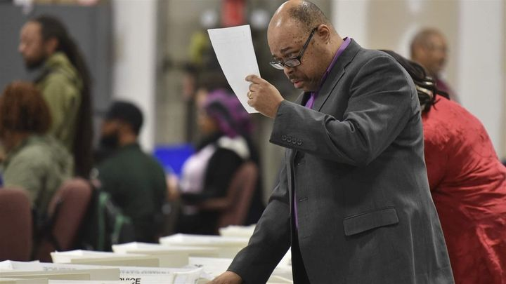 Workers recount the votes cast in the Atlanta mayoral election runoff in Fulton County, Georgia, in 2017. Officials that year