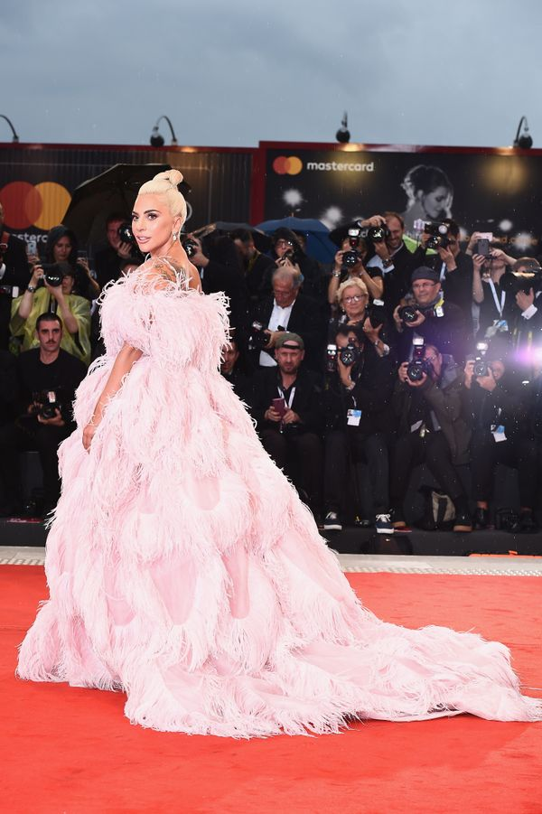 The singer wears Valentino couture for a screening of her upcoming film,