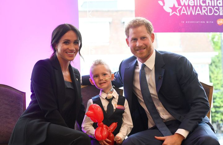 Prince Harry and Meghan Markle meet four-year-old Mckenzie Brackley at the WellChild Awards on Sept 4.