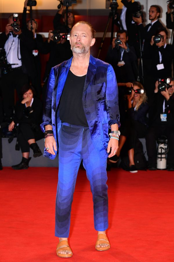 The Radiohead singer wears a bright blue and black suit for the