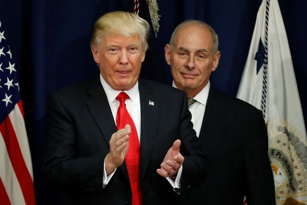 Donald Trump applauds after a ceremonial swearing-in for then US Homeland Security Secretary John F