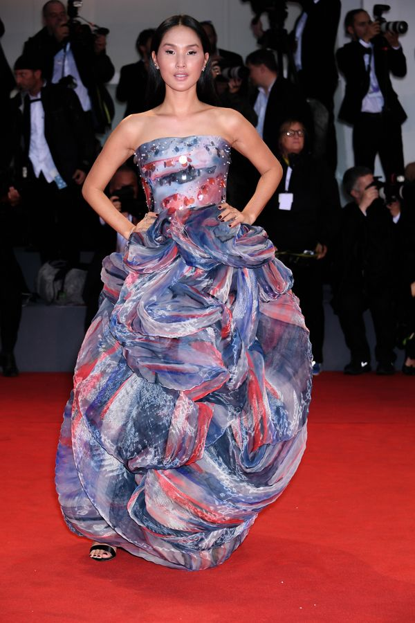 The influencer wears Armani Privé on the red carpet for the