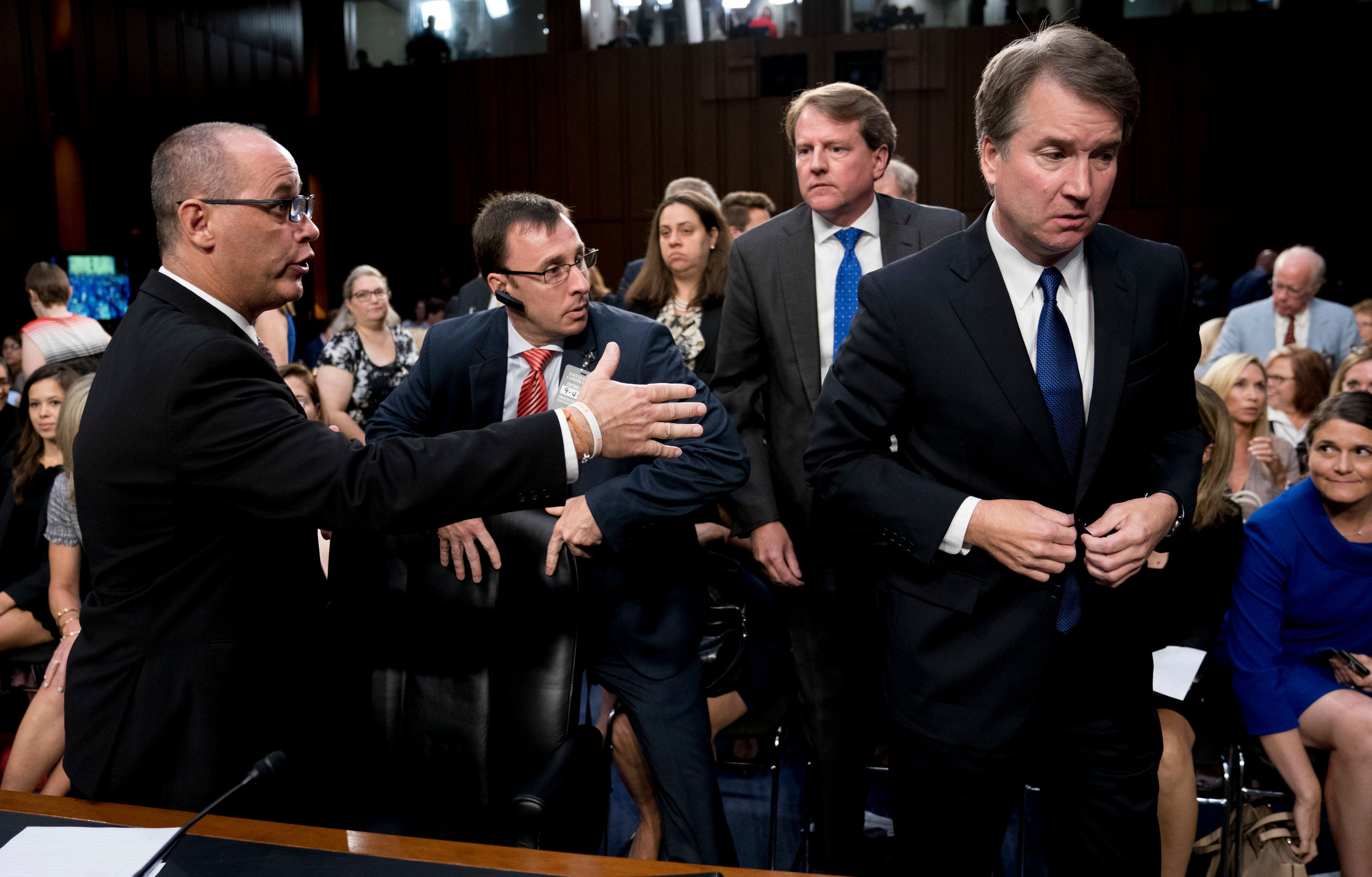 White House counsel Don McGahn, second from right, watches as Guttenberg attempts to shake hands with Kavanaugh.