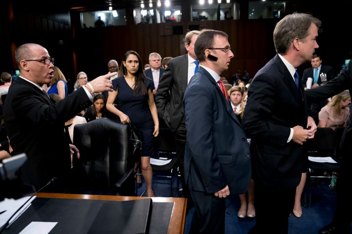 Guttenberg speaks as Kavanaugh moves away from him after rebuffing Guttenberg's attempt at a handshake.