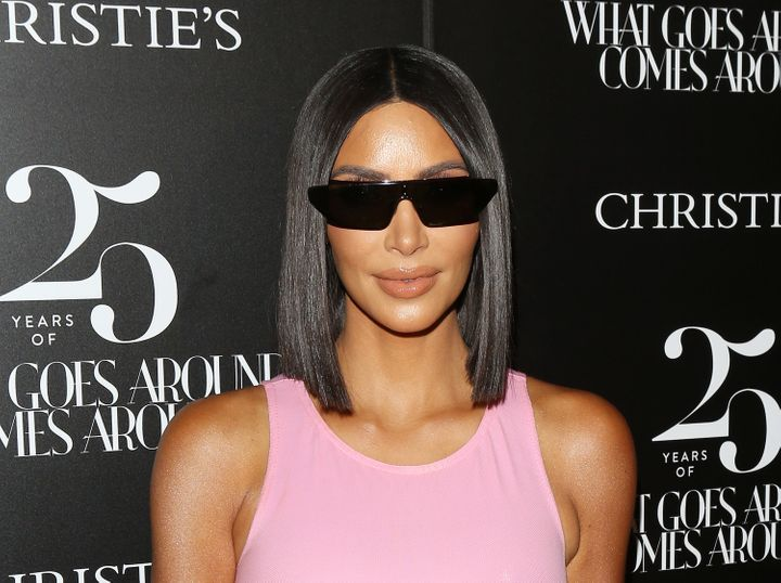 Kim Kardashian and her sunglasses attend the What Goes Around Comes Around 25th Anniversary Auction in Beverly Hills on