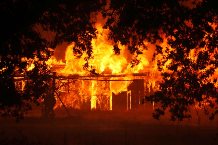 An out-of-control fire burns in Lakeport, California. Events like 2018's California wildfires could become average.