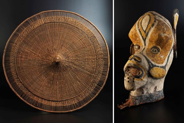 This photo features an indigenous shield and a mask from the 19th century from the museum's Amazonian exhibition.