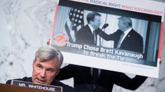 UNITED STATES - SEPTEMBER 04: Sen. Sheldon Whitehouse, D-R.I., speaks during the Senate Judiciary Committee confirmation hearing for Supreme Court nominee Brett Kavanaugh in Hart Building on September 4, 2018. The hearing was delayed by motions to adjourn by Democratic senators and interruptions by protesters. (Photo By Tom Williams/CQ Roll Call)