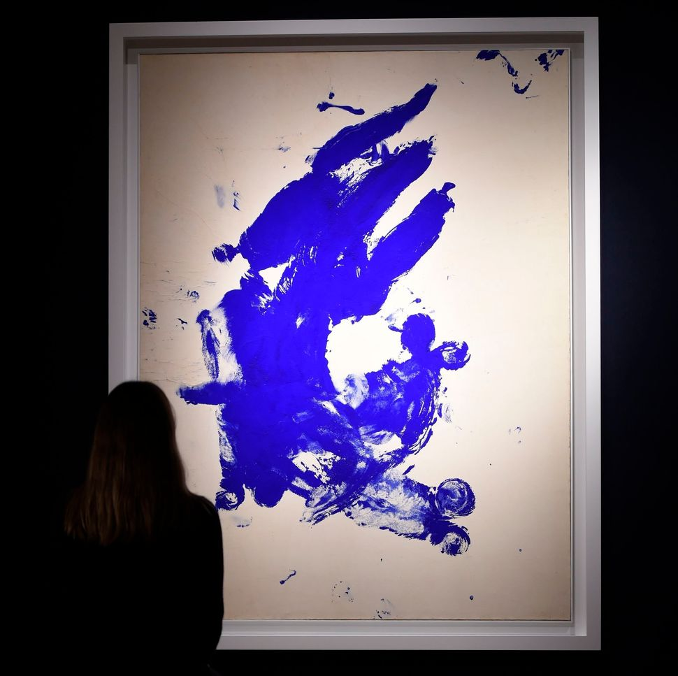 "A woman looks at ""Anthropometrie sans titre (Untitled Anthropometry)"" by Yves Klein at Christie's in London."