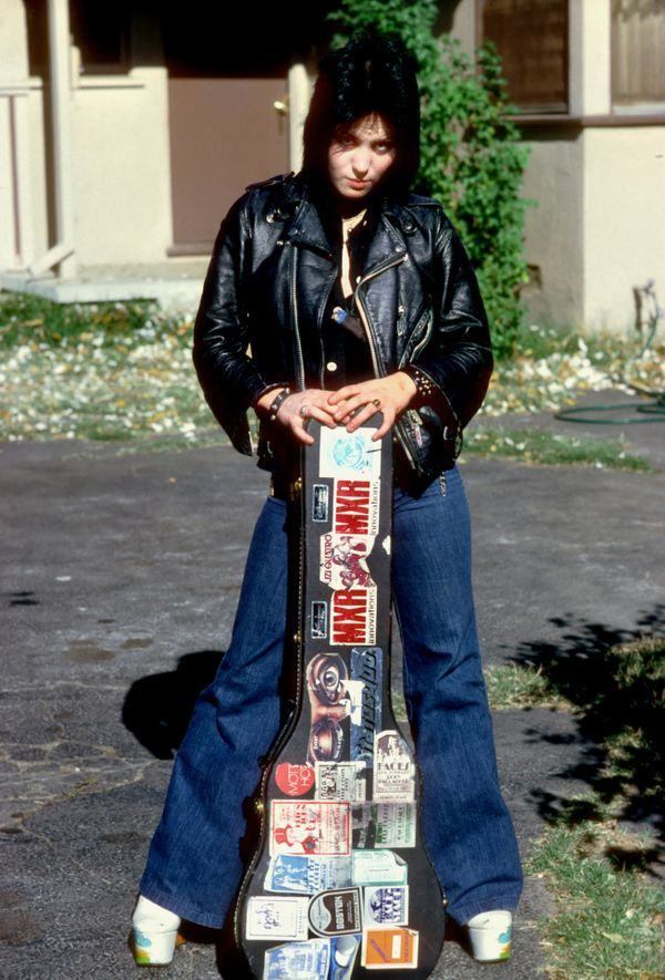 Jett poses for a portrait by her family's home in Canoga Park just outside Los Angeles, in the late '70s.