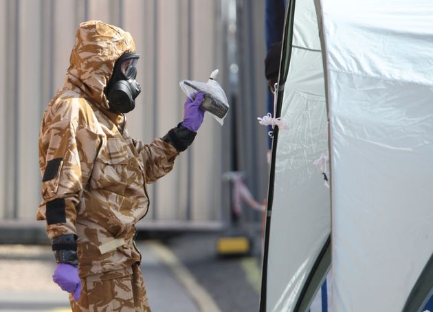 An investigator in a chemical suit in Salisbury,