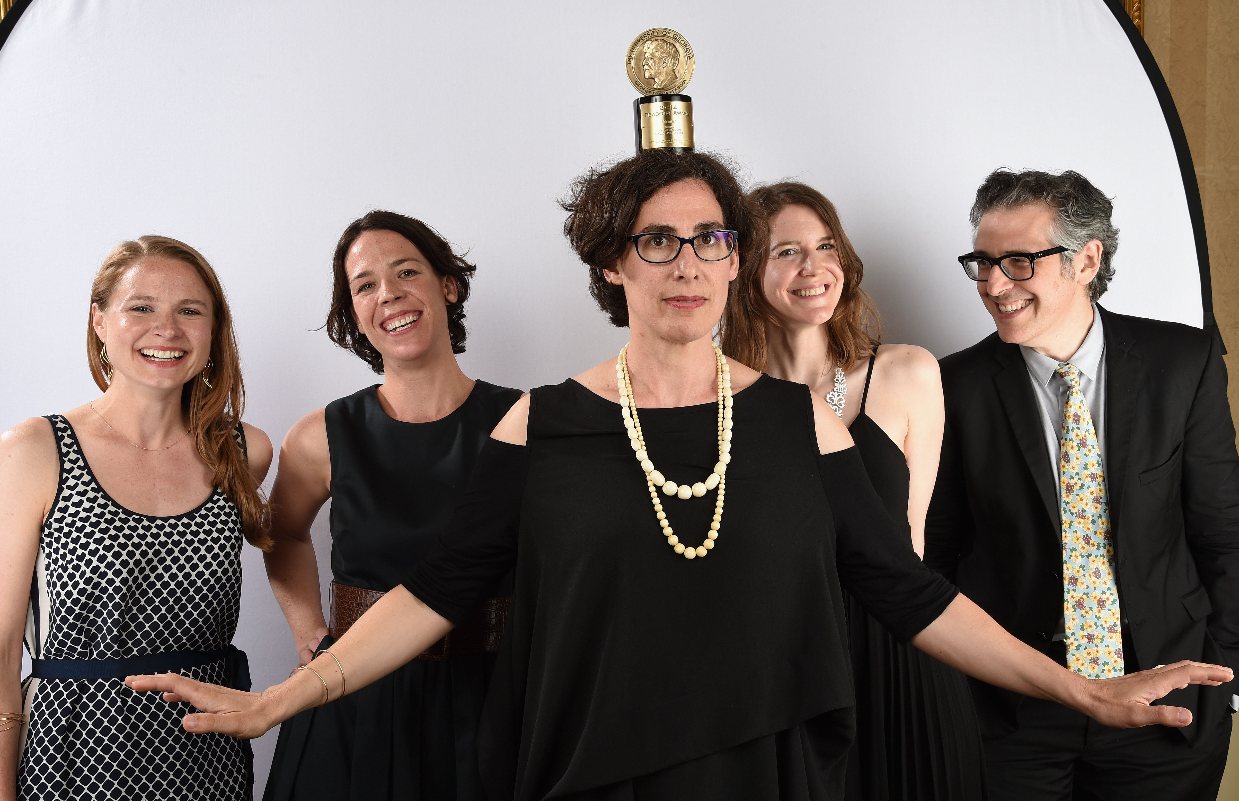 "The team behind ""Serial,"" led by Sarah Koenig (center), with ""This American Life"" host Ira Glass (right), posing with their P"