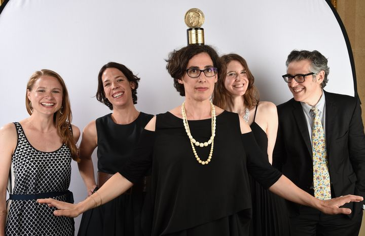 """The team behind """"Serial,"""" led by Sarah Koenig (center), with """"This American Life"""" host Ira Glass (right), posing with their P"""