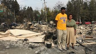 Marion and Lloid Heim stand amid the ashes of their Santa Rosa home days after the fire hit