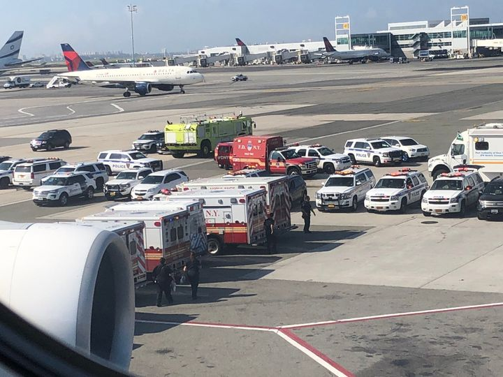A photo reportedly taken by a passenger onboard the flight at JFK Airport shows a number of emergency vehicles outside.