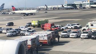 A photo reportedly taken by a passenger onboard the flight at JFK Airport shows a number of emergency vehicles outside