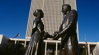 Statue of Joseph and Emma Smith, founders of the Mormon Church, in front of the Church Office Building, headquarters of The Church of Jesus Christ of Latter-day Saints. | Located in: Salt Lake City.