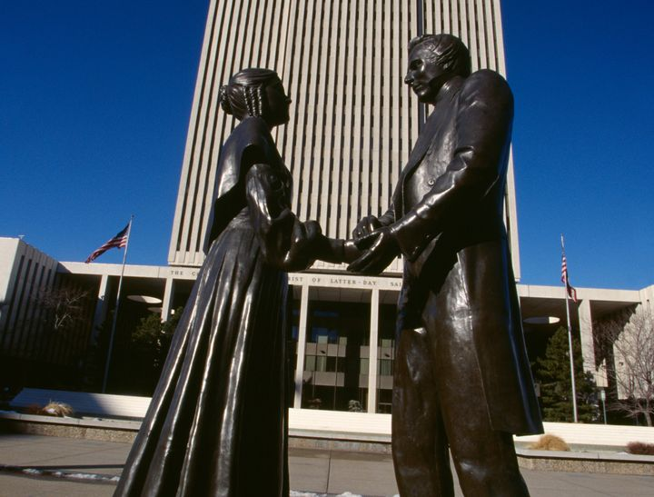 Statues of Joseph Smith and his wife Emma stand in front of the headquarters of The Church of Jesus Christ of Latter-day Sain
